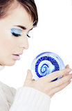 Girl holding crystal ball Stock Images