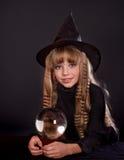 Girl holding crystal ball. Royalty Free Stock Photo