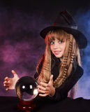 Girl holding crystal ball. Stock Images