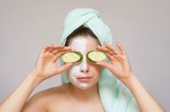 Girl holding a cucumbers in front of her eyes like a binoculars. royalty free stock image