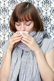 Girl holding a cup. The girl in a scarf, holding a tea cup. It is concentrated to a cup Royalty Free Stock Photo