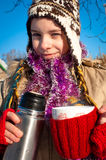Girl holding a cup. With hot drink Stock Photography