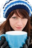 Girl holding a cup Royalty Free Stock Image