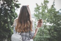 Girl holding cup of coffee Stock Photography