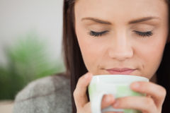 Girl holding a cup of coffee Stock Photography