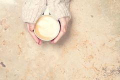 Girl holding cup of coffee with latte art. Leasure time concept. Royalty Free Stock Images