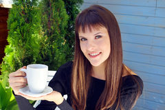 Girl holding a cup of coffee and smiled pleasantly Royalty Free Stock Images
