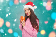 Girl holding cup with hot drink Royalty Free Stock Photo