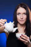 Girl holding cup of tea Stock Images