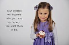 Girl holding cupcake Stock Image
