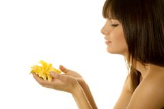 Girl holding a daisy Stock Photos