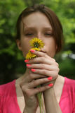 Girl holding dandelion Stock Photography