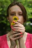 Girl holding dandelion Stock Photography