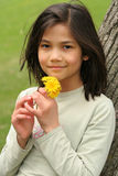 Girl holding dandelions Royalty Free Stock Images