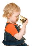 Girl holding a dark mug Stock Images