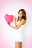 Girl holding decorative heart Royalty Free Stock Images