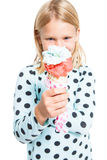 Girl holding a delicious ice cream cone Royalty Free Stock Photo