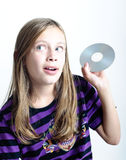 Girl holding a disc Royalty Free Stock Image