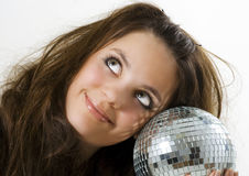 Girl holding a disco ball Royalty Free Stock Images