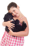 Girl holding dog Royalty Free Stock Photo