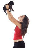 Girl holding dog Stock Photo