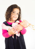 Girl holding the doll Stock Image
