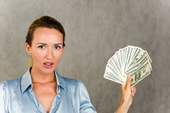 Girl holding dollars Stock Images