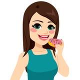 Girl Holding Doughnut. Beautiful girl enjoying holding sweet chocolate doughnut Stock Image