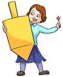 Girl holding dreidel. Little girl holding a large Chanuka dreidel spinning top Royalty Free Stock Image