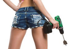 Girl holding a drill near the booty Stock Image