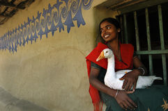 Girl holding a duck Royalty Free Stock Photo