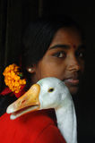 Girl holding a duck Royalty Free Stock Images