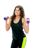 Girl holding a dumbbell Royalty Free Stock Photo