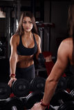 Girl holding a dumbbell Stock Images