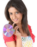 girl holding a dvd Royalty Free Stock Photography