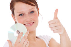 Girl holding dvd and showing thumbs up Stock Images