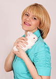 Girl holding dwarf white rabbit Royalty Free Stock Photography