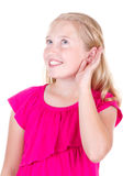 Girl holding ear listening. Isolated on white stock images
