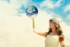 Girl holding earth Stock Photos