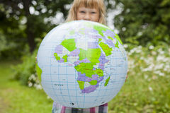 Girl holding an earth globe Royalty Free Stock Images