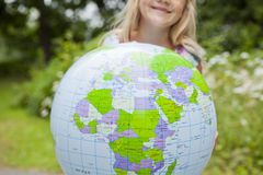 Girl holding an earth globe Stock Photography