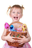 Girl Holding Easter eggs and basket Royalty Free Stock Photography