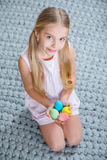 Girl holding Easter eggs. Cite little girl holding colorful Easter eggs and smiling Royalty Free Stock Photography