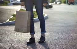Girl holding ecological shopping with paper bag in hand. Royalty Free Stock Photography