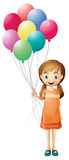 A girl holding eight colorful balloons Royalty Free Stock Images
