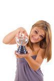 Girl holding electric vitreous heart of glass Royalty Free Stock Image