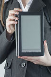 Girl holding a electronic book reader. With copy space Royalty Free Stock Image