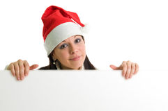 Girl holding empty board. Young attractive brunette holding empty board. Isolated over white Stock Photography
