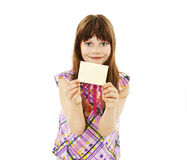 Girl holding empty card. Gift card sign little girl. Excited little girl showing empty blank paper note copy space. Isolated on white background royalty free stock images
