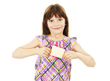 Girl holding empty card. Gift card sign little girl. Excited little girl showing empty blank paper note copy space. Isolated on white background stock photo
